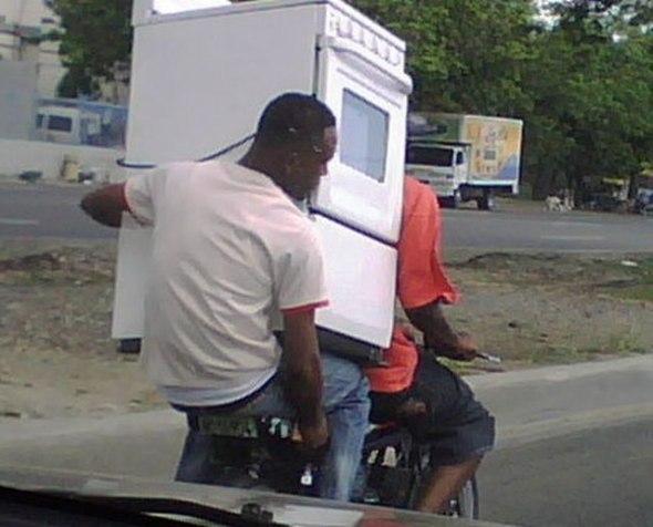 black man transferring stove